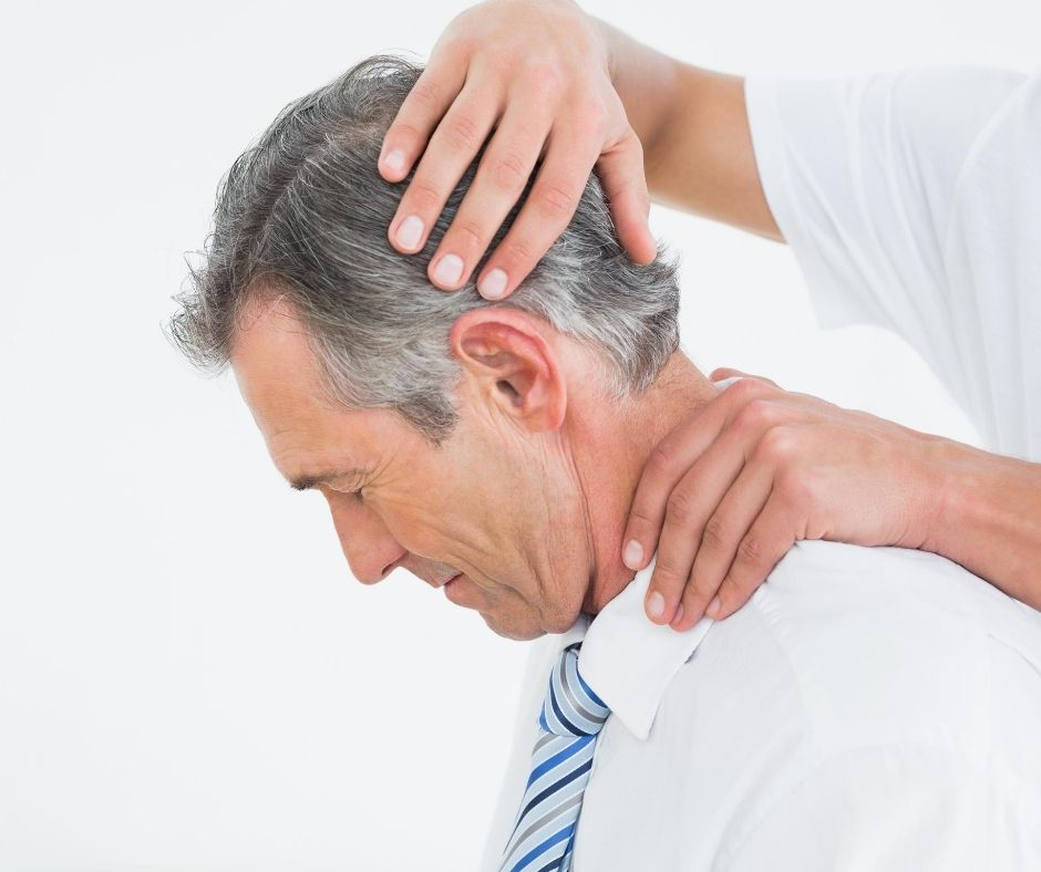 man getting his neck adjusted