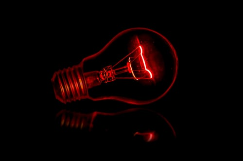 red light bulb in a dark room