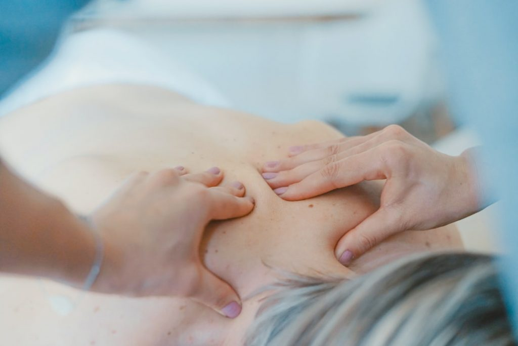 woman getting her back massaged