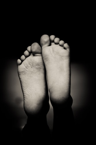 black and white image of the underside of feet