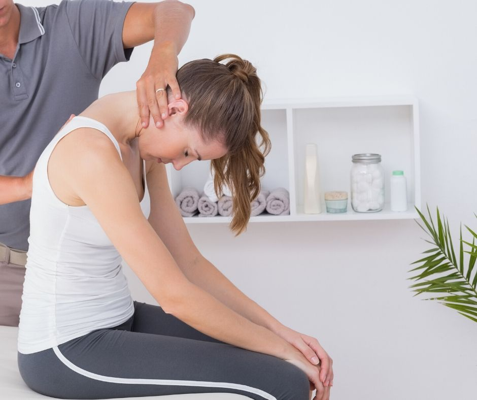 woman getting a chiropractic adjustment for lower back pain treatment